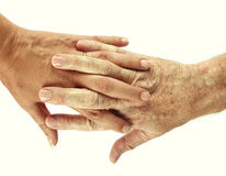 Couple interlinked hands over white background Royalty Free Stock Photos