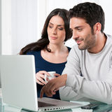 Couple with internet laptop Stock Photos