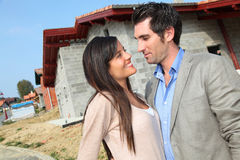 Couple investing in house Stock Photography