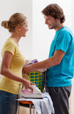 Couple ironing clothes stock photography