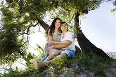 Couple on the island under the tree Stock Photo