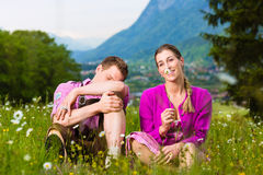 Couple with issues in Alpine meadow Stock Images