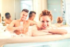Couple in jacuzzi pool Stock Image