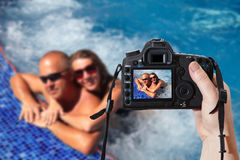 Couple in jacuzzi. Reflex camera Royalty Free Stock Photos
