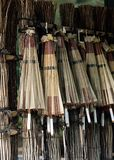 A couple of Japanese colorful wooden umbrellas hanging for sale background royalty free stock images