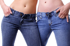 Couple in jeans. Two models in jeans from front stomach Stock Images