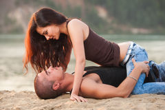 Couple in jeans on the beach royalty free stock photography