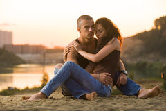 Couple in jeans on the beach stock photography