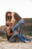 Couple in jeans. Couple having fun on the beach Royalty Free Stock Photography