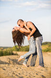 Couple in jeans. Having fun on the beach Royalty Free Stock Photos