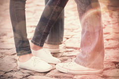 Couple in jeans standing on path Royalty Free Stock Image