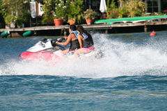 Couple on a jet ski Royalty Free Stock Photo