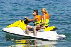 Couple on jet ski. Couple on Wave Runner jet ski Royalty Free Stock Photo