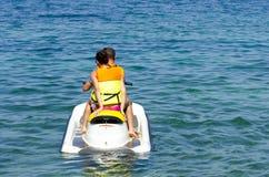 Couple on jet ski starts ride on sea surface. Couple on jet ski starts ride on sea water surface Royalty Free Stock Photo
