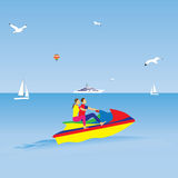 Couple on a jet ski. Summer vacation. Water sports. Royalty Free Stock Image
