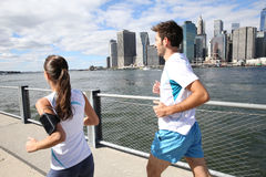 Couple of joggers running on bridge in new york. Couple of joggers running on Brooklyn Heights Promenade royalty free stock photo