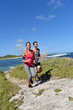 Couple of joggers running on the coastline Royalty Free Stock Photos