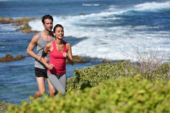 Couple of joggers running on the seaside Royalty Free Stock Photos
