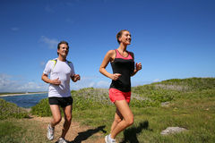 Couple of joggers beside the sea Stock Photography