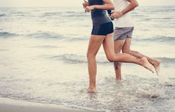 Couple jogging at the beach royalty free stock photos