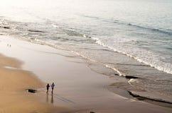 Couple jogging at the beach stock photos