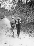 Couple jogging through the country side Royalty Free Stock Photography