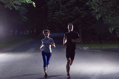 Couple jogging at early morning Royalty Free Stock Images