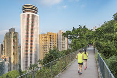 Couple jogging for fitness in. Urban sports - couple jogging for fitness in Hong Kong city with skyscraper background Royalty Free Stock Photos