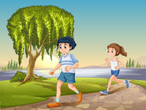 Couple jogging. Man and woman jogging in the park at daytime Royalty Free Stock Image