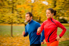 Couple jogging in nature - motion blur Stock Photo