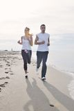 Couple Jogging On The Beach Royalty Free Stock Photos