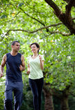 Couple jogging outdoors Stock Photography