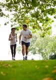 Couple jogging outdoors Royalty Free Stock Image
