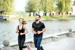 Couple jogging outdoors royalty free stock images