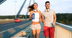 Couple jogging outdoors. Couple jogging and running outdoors in nature Royalty Free Stock Photography