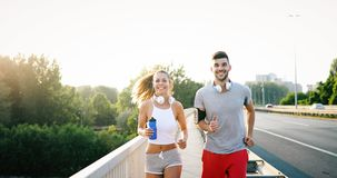 Couple jogging outdoors. Couple jogging and running outdoors in nature Stock Photos