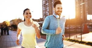 Couple jogging outdoors. Couple jogging and running outdoors in nature Royalty Free Stock Photos