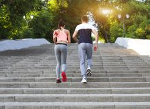 Couple jogging outside, runners training outdoors working out in Royalty Free Stock Photography