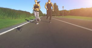 Couple jogging in the park. 4k, 25 fps stock video