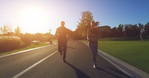 Couple jogging in the park stock footage