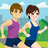 Couple Jogging Park. Young athlete couple jogging together at park trail Stock Images