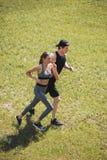 Couple jogging in park Stock Photos