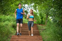 Couple Jogging In Park Royalty Free Stock Photo