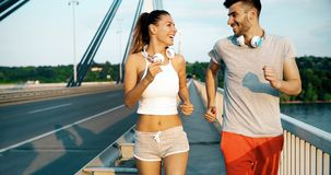 Couple jogging outdoors. Couple jogging and running outdoors in nature Stock Photography