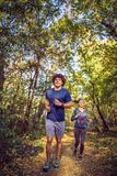 Couple jogging and running outdoors in nature royalty free stock image