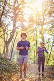 Couple jogging and running outdoors in nature- healthy lifestyle royalty free stock photos