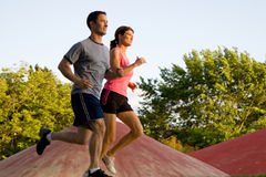 Couple Jogging Together - horizontal Stock Photo