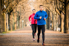 Couple jogging together Royalty Free Stock Photos