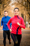 Couple jogging together Stock Photos