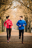 Couple jogging together Royalty Free Stock Images